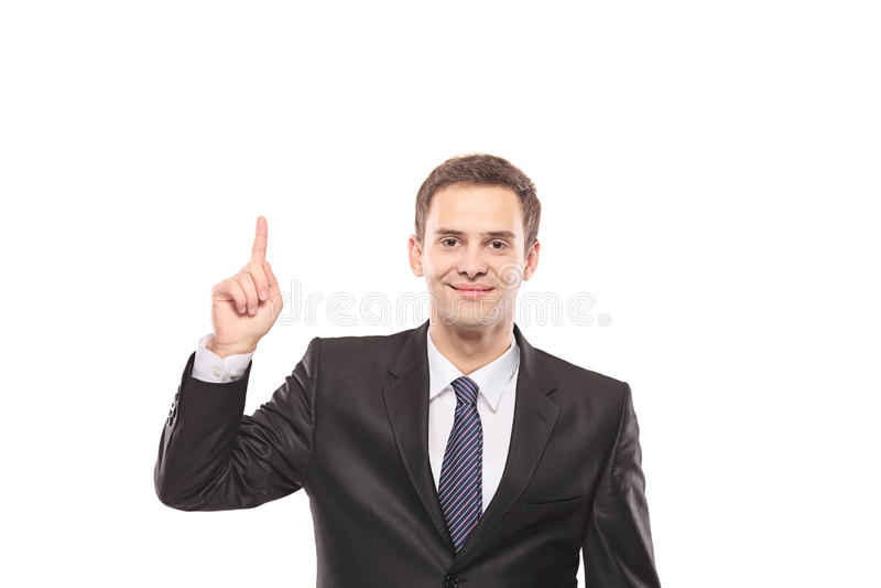 Junger Geschäftsmann, der oben mit seinem Finger zeigt stockbild