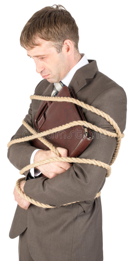 Junger Geschäftsmann gebunden mit Seilen stockbild