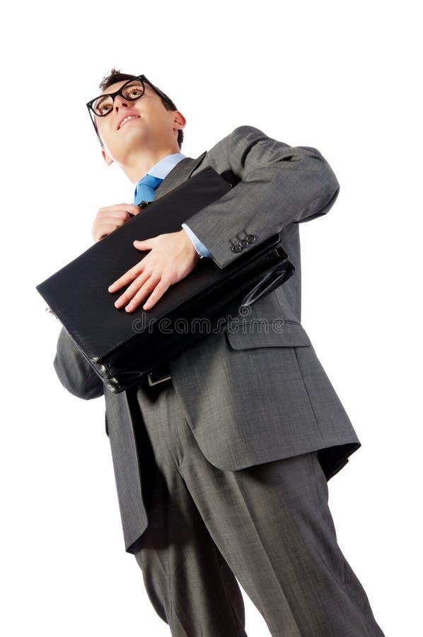 Junger Geschäftsmann mit einem Portefeuille stockfotos