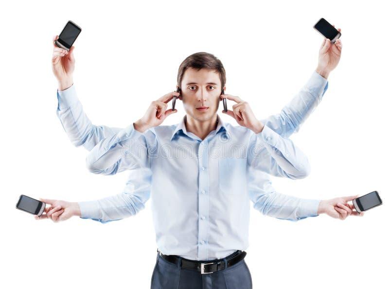Junger Geschäftsmann mit sechs Händen und mit Telefon stockfotografie