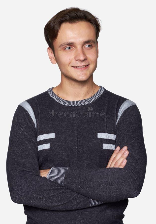 Junger gutaussehender Mann, der weg schaut Getrennt lizenzfreie stockfotografie