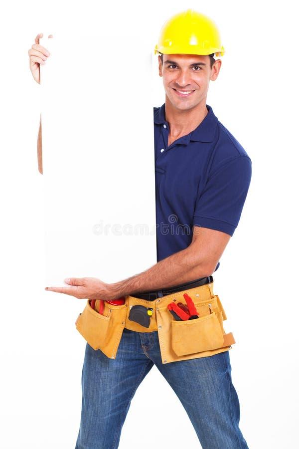 Heimwerker, der Fahne hält lizenzfreie stockfotos