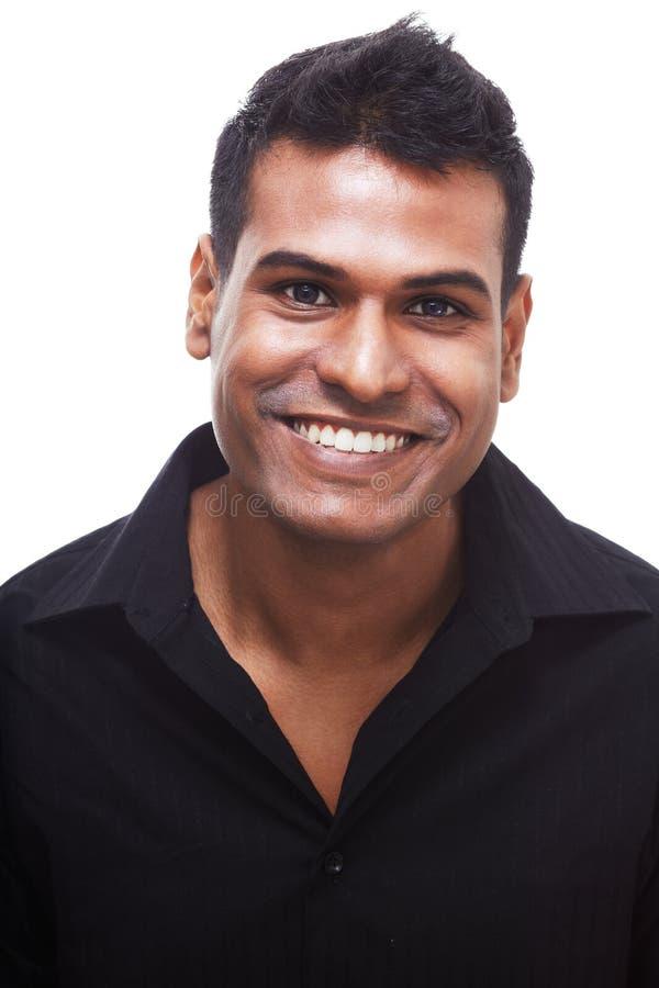 Junger indischer Geschäftsmann mit Begr5us$ungslächeln lizenzfreies stockbild