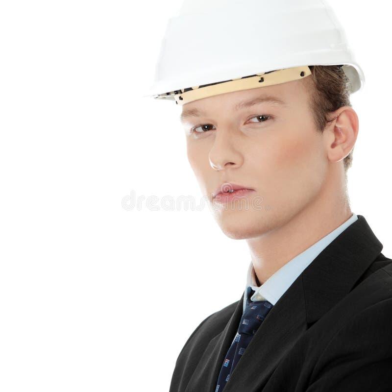 Junger Ingenieur im Sturzhelm lizenzfreies stockbild
