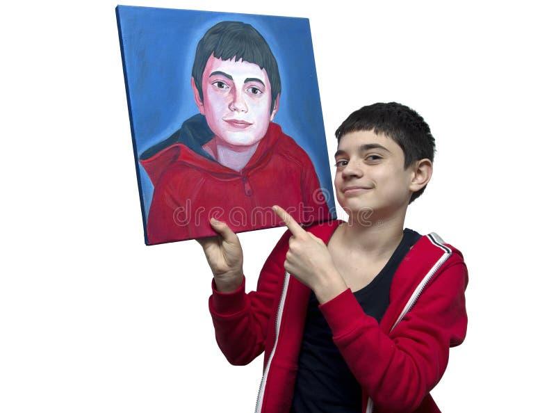 Junger Künstler, der sein Selbstporträt zeigt stockfotos