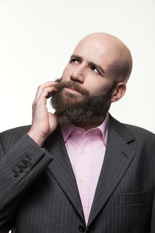 Junger kahler Mann mit einem Bart lizenzfreies stockbild