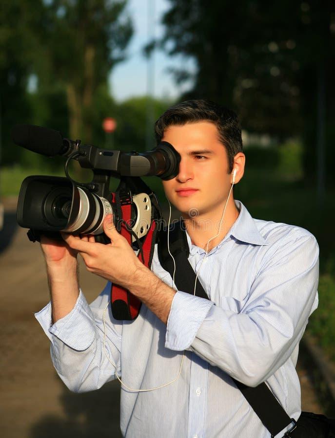 Junger Kameramann lizenzfreie stockfotografie