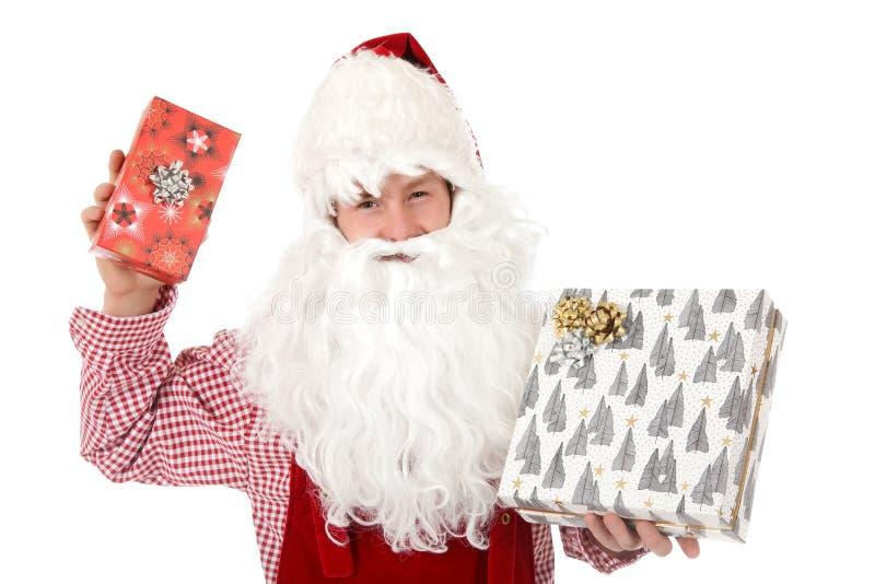Junger kaukasischer Mann Weihnachtsmann, Geschenke lizenzfreies stockfoto