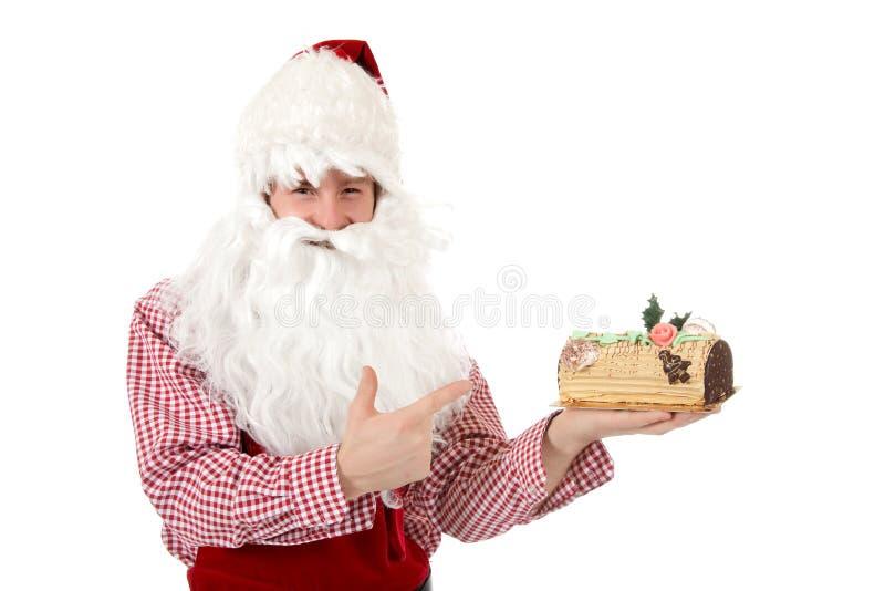 Junger kaukasischer Mann Weihnachtsmann, Kuchen lizenzfreie stockfotografie