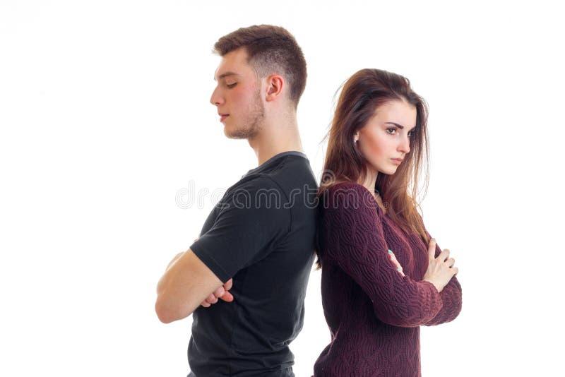 Junger Kerl und Mädchen stehen Rückseiten miteinander mit den gefalteten Händen lizenzfreies stockbild