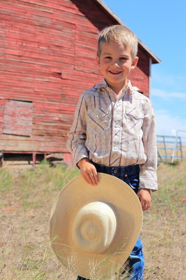Junger lächelnder Cowboy lizenzfreies stockfoto