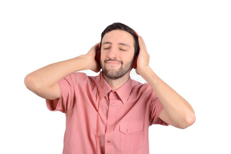 Junger lustiger Mann mit Kopfhörern stockbilder