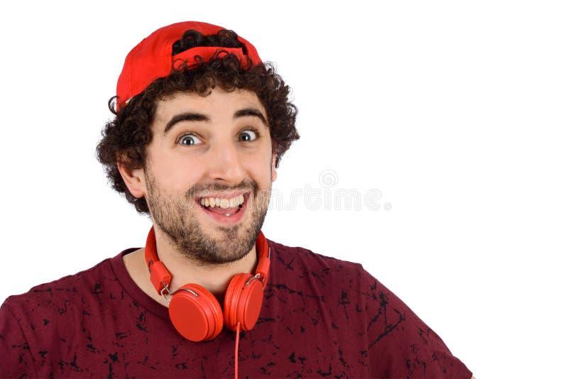 Junger lustiger Mann mit Kopfh?rern stockfotografie