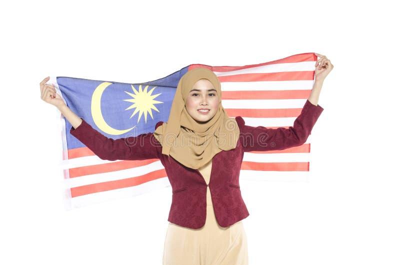 Junger malaysischer Zivilist mit glücklichem Gesicht Unabhängigen feiernd lizenzfreie stockfotografie