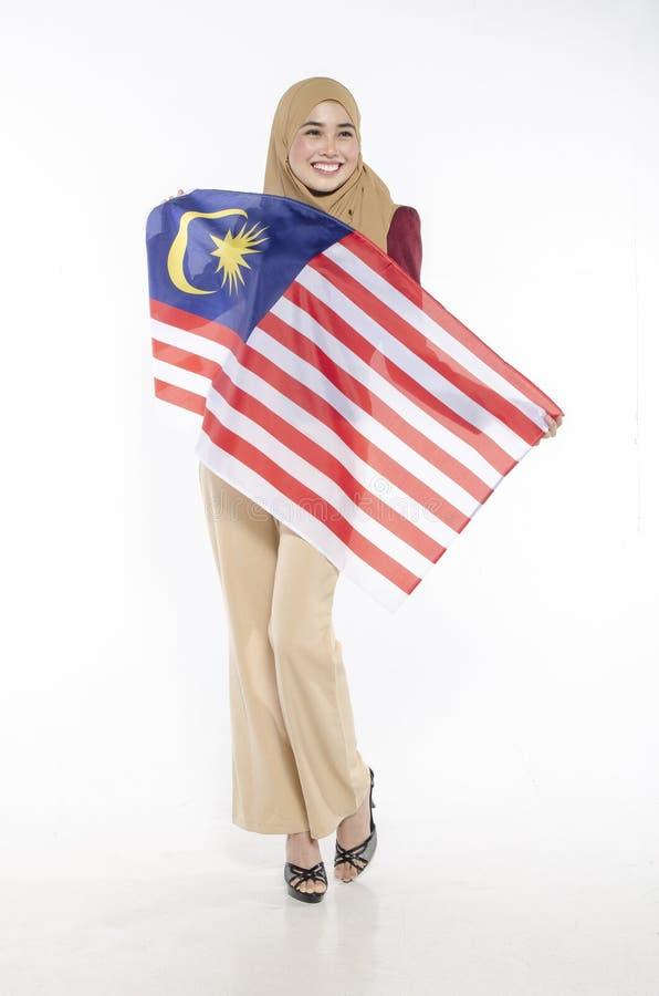 Junger malaysischer Zivilist mit glücklichem Gesicht Unabhängigen feiernd stockbild