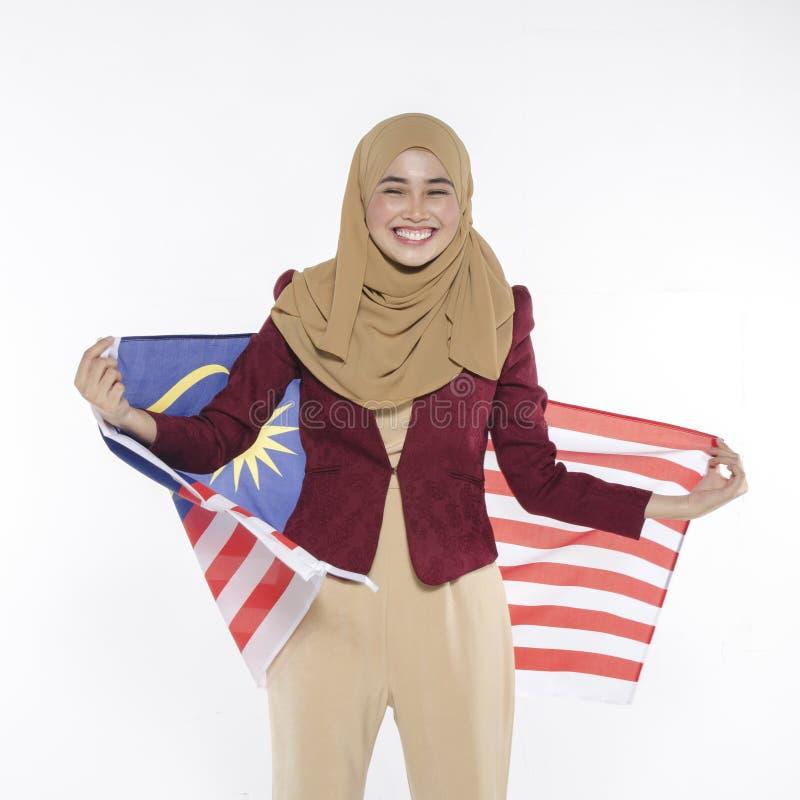 Junger malaysischer Zivilist mit glücklichem Gesicht Unabhängigen feiernd lizenzfreie stockfotos