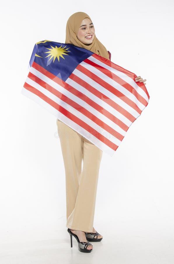 Junger malaysischer Zivilist mit glücklichem Gesicht Unabhängigen feiernd stockfoto
