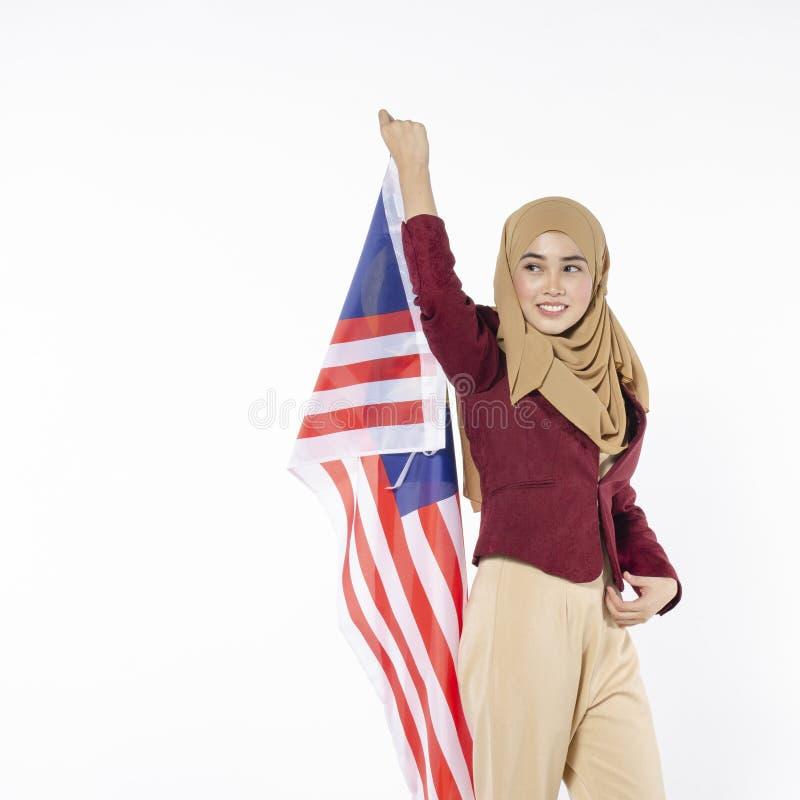 Junger malaysischer Zivilist mit glücklichem Gesicht Unabhängigen feiernd lizenzfreies stockbild