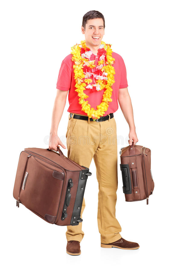 Junger Mann bereitete sich für Abflug vor und warf mit seinem Gepäck auf lizenzfreies stockbild