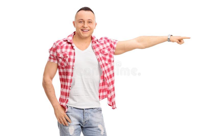 Junger Mann, der nach rechts mit seiner Hand zeigt lizenzfreie stockbilder