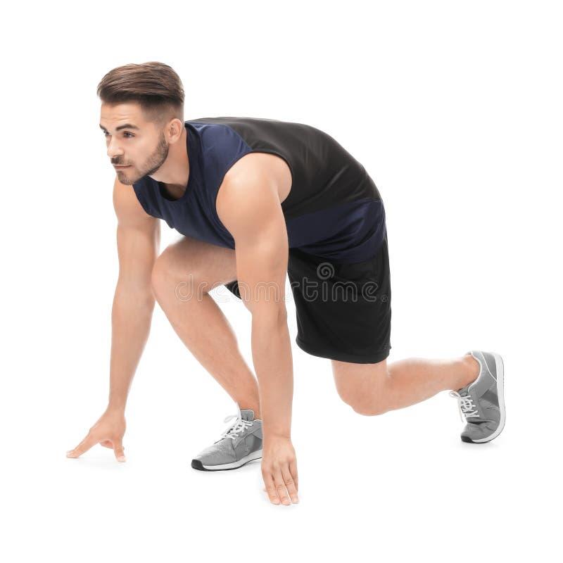 Junger Mann in der Sportkleidung, die sich vorbereitet zu laufen stockbilder