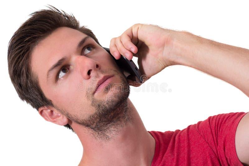 Junger Mann, der am Telefon spricht lizenzfreie stockfotografie