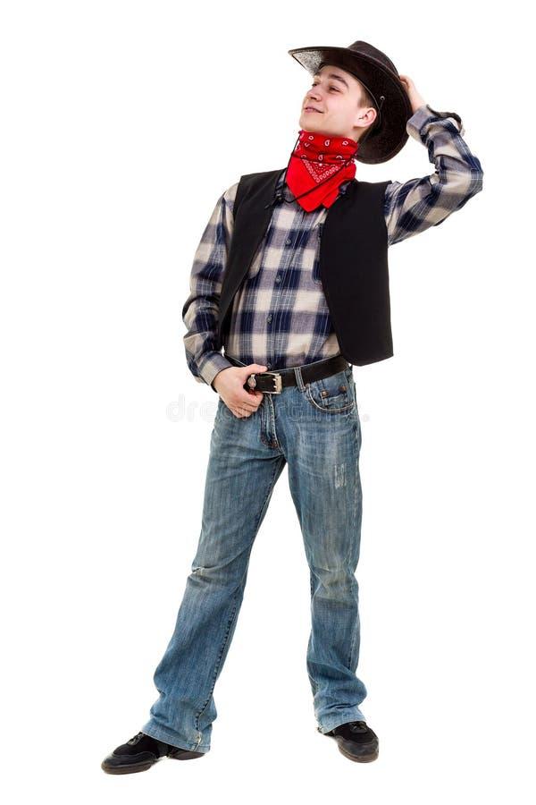 Junger Mann in einem Cowboyhut, lokalisiert auf weißem Hintergrund in voller Länge stockfotografie