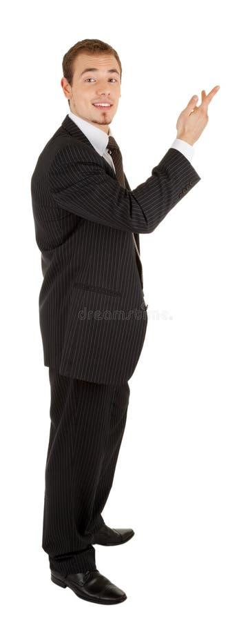 Junger Mann in einem schwarzen Anzug stockfotografie