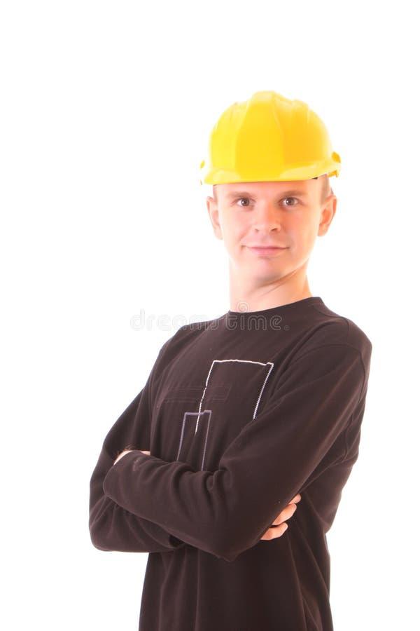 Junger Mann im gelben Sturzhelm getrennt lizenzfreie stockfotografie