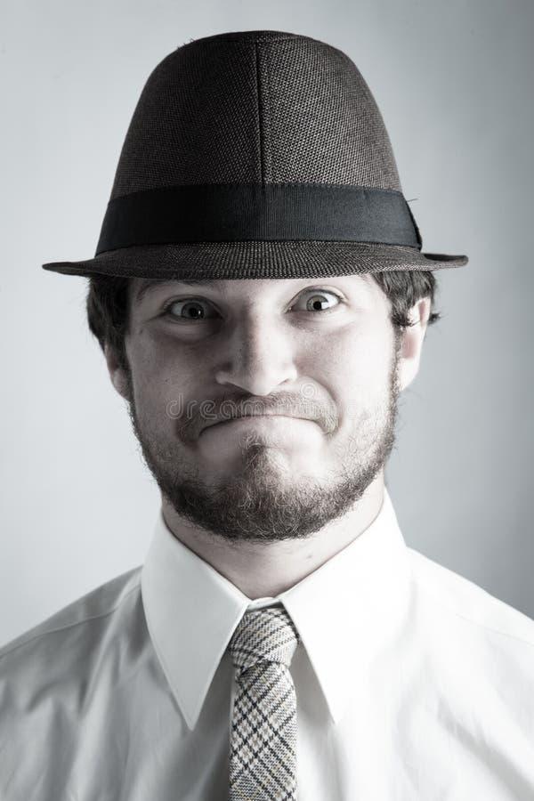 Junger Mann im Hut lizenzfreie stockfotos