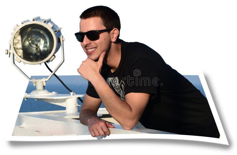 Junger Mann knallen heraus von einem Bild lizenzfreies stockfoto