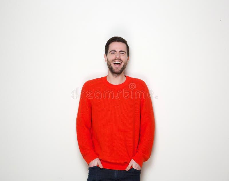 Junger Mann mit dem Bartlachen stockbilder