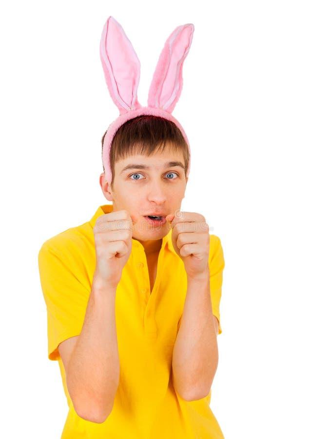 Junger Mann mit den Hasenohren stockfotos