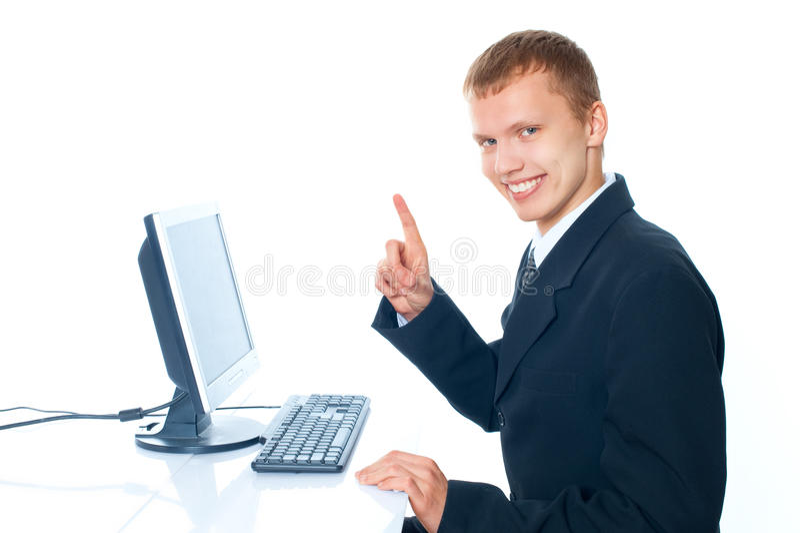 junger Mann mit einem Computer stockfotos