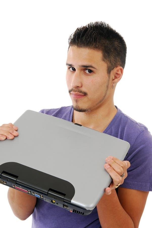 Junger Mann mit einem Computer stockbild