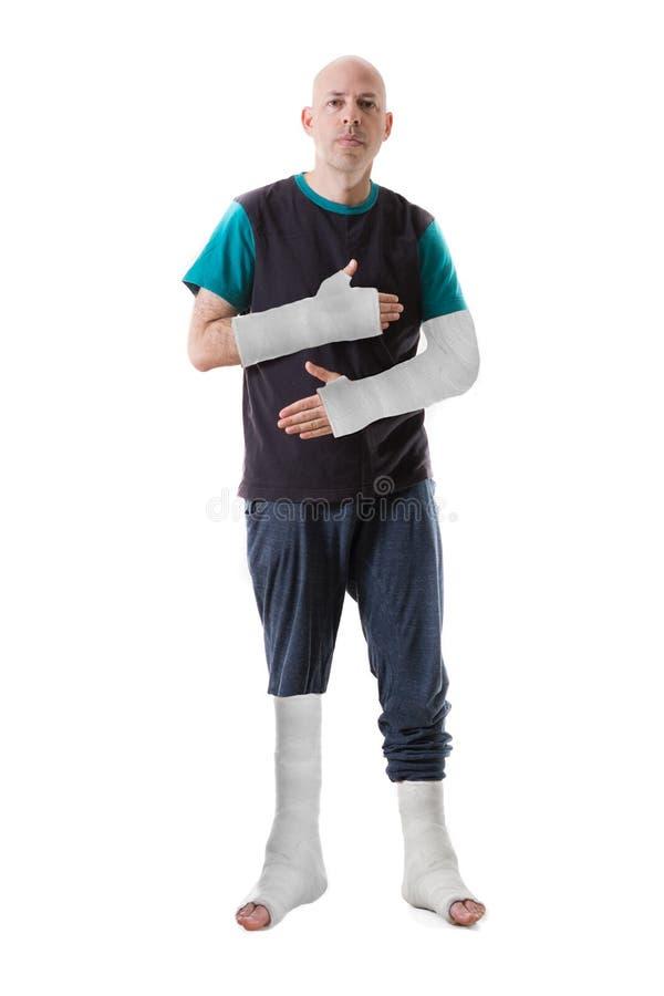 Junger Mann mit einem gebrochenen Knöchel und einer Beinform lizenzfreie stockbilder