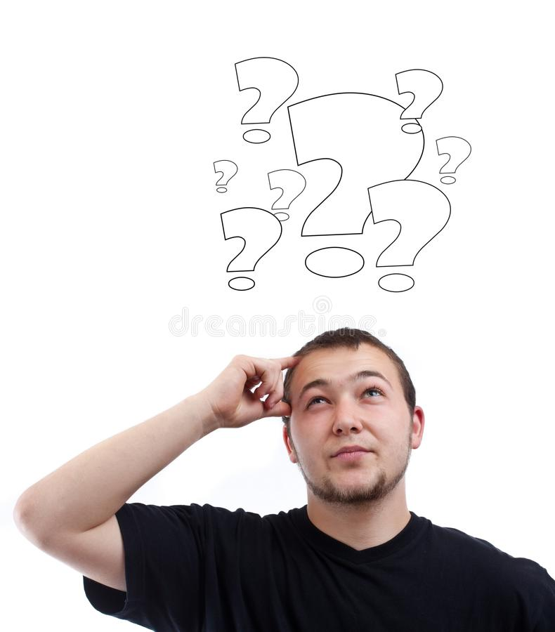 Junger Mann mit Fragezeichen lizenzfreie stockfotografie