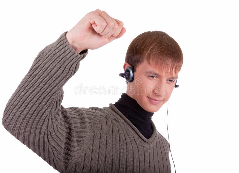 Junger Mann mit Kopfhörern stockbild