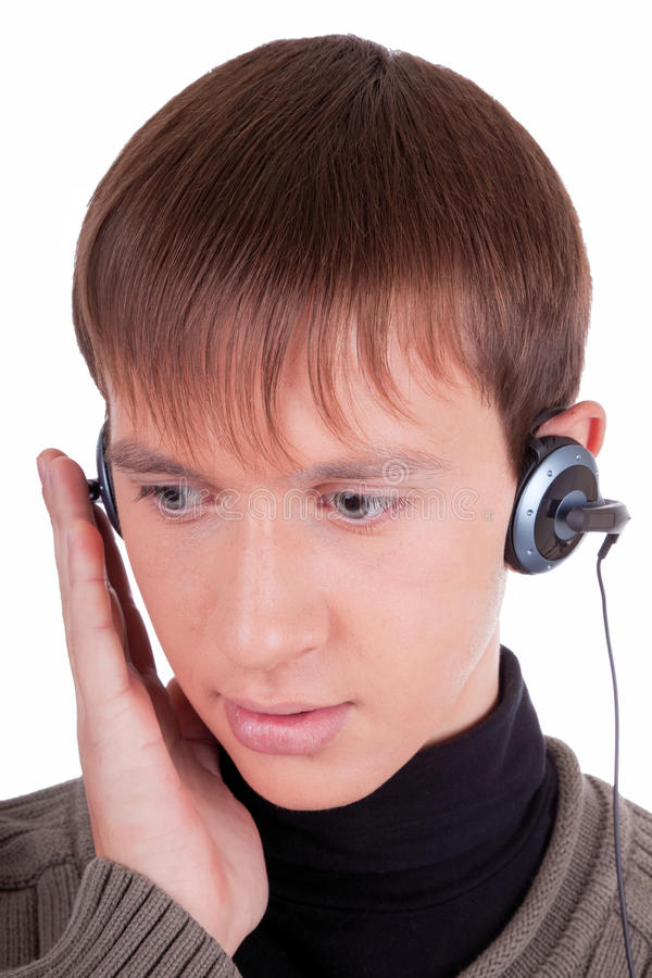 Junger Mann mit Kopfhörern stockfotos