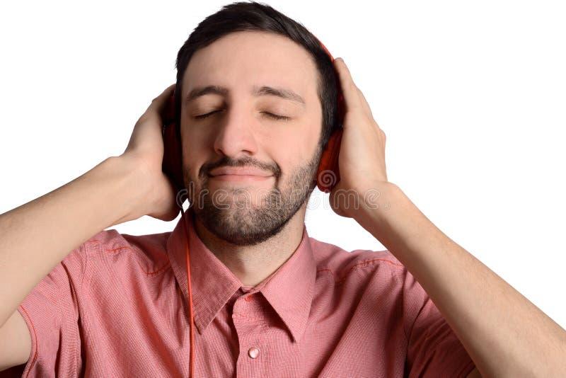 Junger Mann mit Kopfh?rern lizenzfreies stockbild