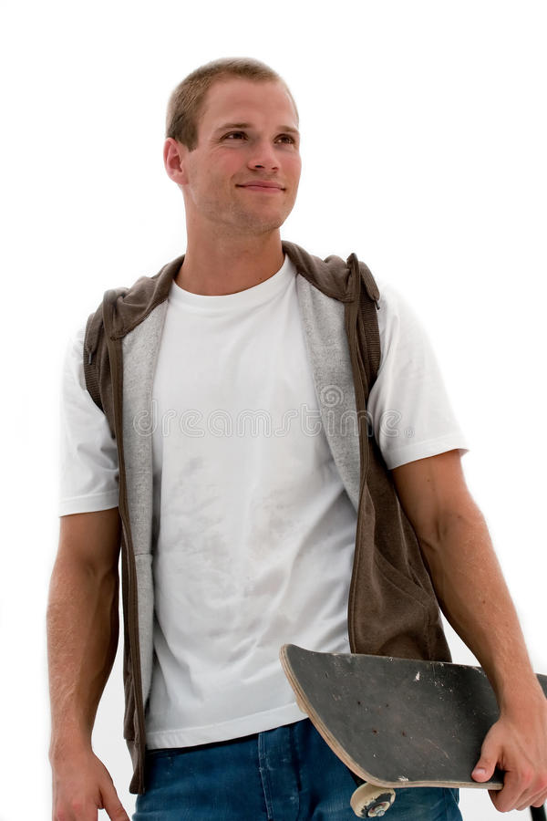 Junger Mann mit Skateboard stockfoto