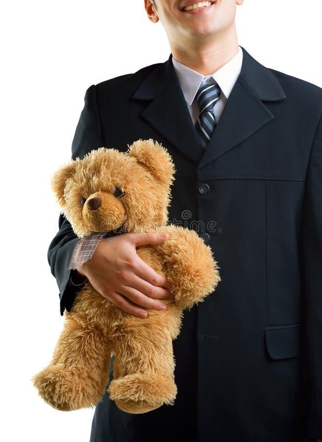 Junger Mann mit Teddybären lizenzfreies stockbild