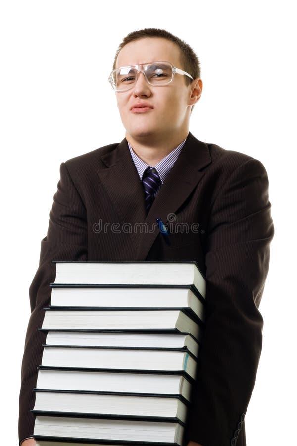 Junger Mann tragen Stapel der Bücher stockbilder