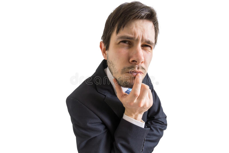 Junger misstrauischer oder skeptischer Mann ist, betrachtend hörend und Sie Getrennt auf weißem Hintergrund stockfotografie