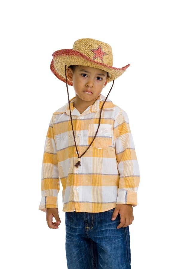 Junger, netter Junge mit Cowboyhut stockfotografie