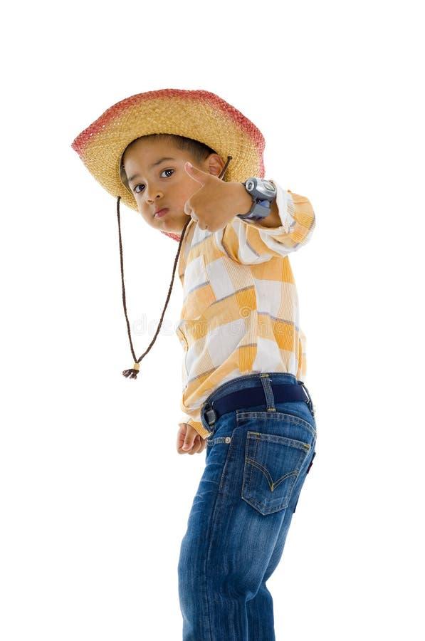 Junger Platzcowboy mit dem Daumen oben lizenzfreie stockfotografie