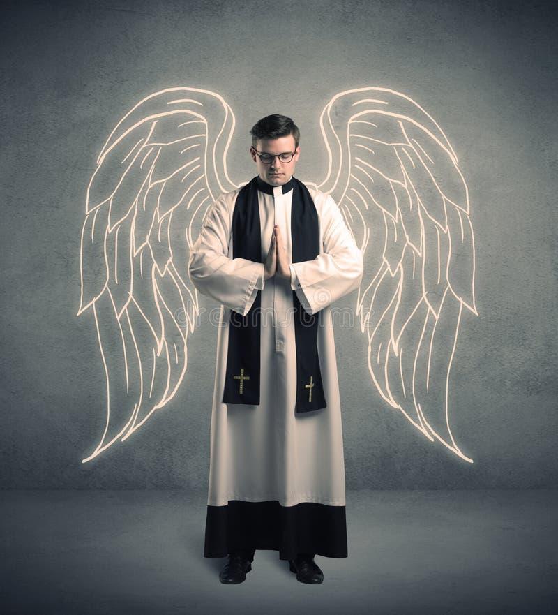 Junger Priester, wenn sein Segen gegeben wird stockfotos