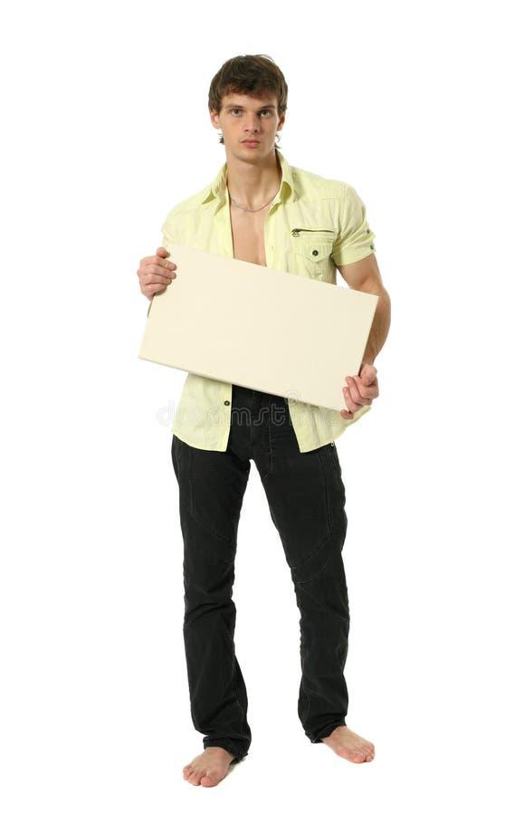 Junger reizvoller Mann mit Exemplar-Platz-Leerzeichen-Zeichen lizenzfreie stockfotos