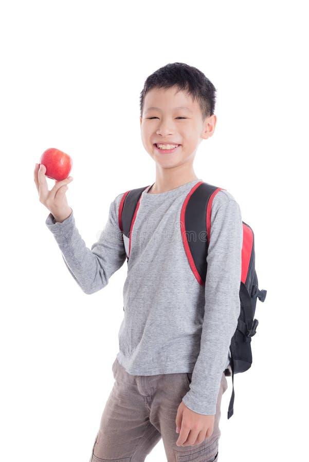 Junger Schüler mit Rucksack lächelnd über Weiß stockfotografie