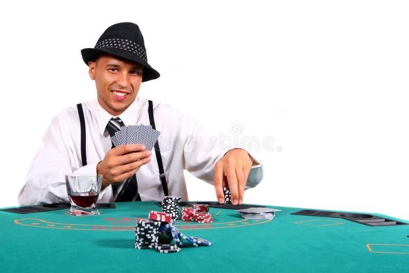 Junger Schürhaken-Spieler auf Tabelle stockfotos